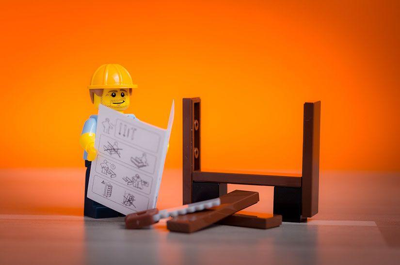 Lego man reading instruction manual