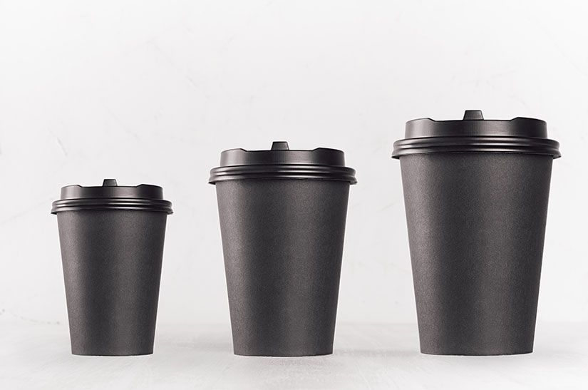 Three takeaway coffee cups in small, medium and large sizes