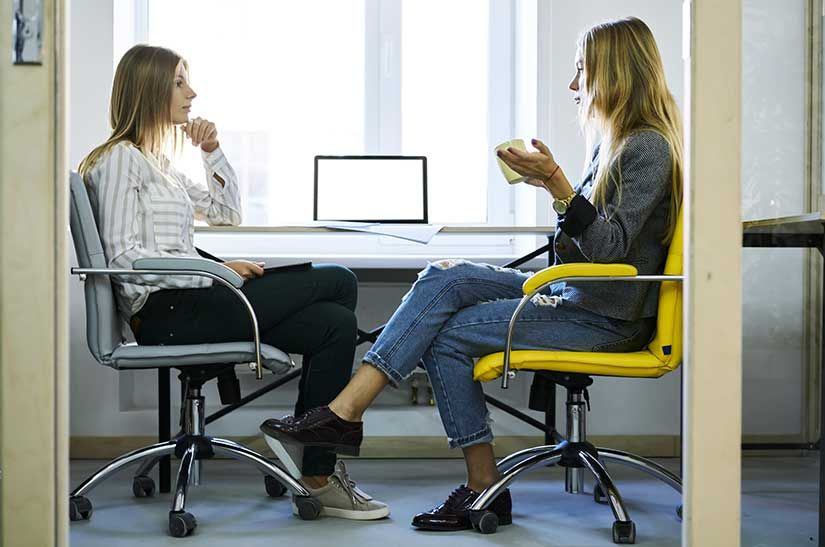 Two office workers in discussion