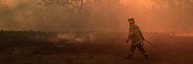 Fireman and bushfire banner